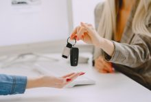 ladies car salon woman buying car elegant woman blue dress manager helps client 1157 44064